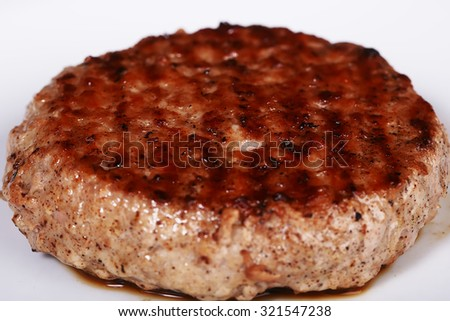 Big tasty appetizing fresh cutlet for burger with meat lying on white background closeup, horizontal picture - stock photo