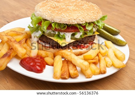 big tasty cheeseburger with french fries