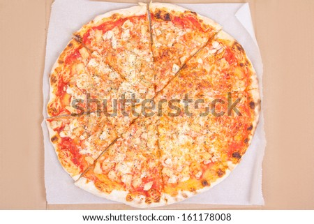big tasty pizza with cheese in carton box - stock photo