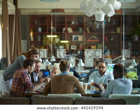 Big team discussing business plans at meeting - stock photo