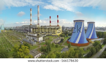 Big territory of power plant at sunny day. View from unmanned quadrocopter. - stock photo