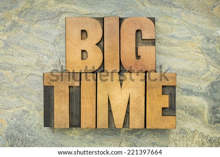 big time - text in vintage letterpress wood type on a green slate rock background - stock photo