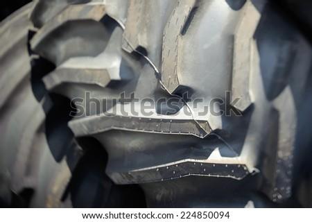 Big tractor wheel closeup - stock photo