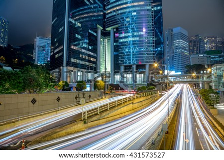 Big Traffic in the modern city - the light trails on the office building background, Hong Kong, China.