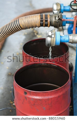Big Truck Hoses for fuel station, pumps and oil barrels - stock photo