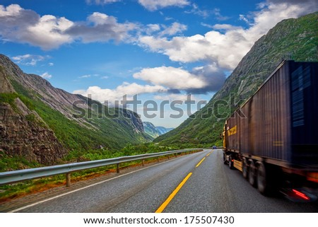 Big truck on a mountain road in Norway. - stock photo