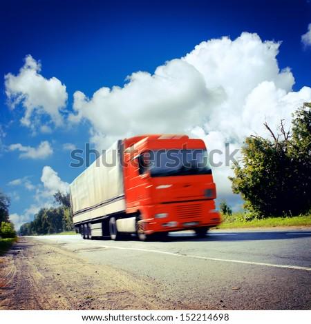 big truck on the asphalt road - stock photo