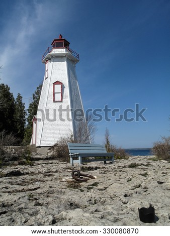 Big Tub  lighthouse in Tobermory along coastline of Bruce Peninsula National Park. Tobermory is a small community located at the northern tip of Bruce Peninsula,Ontario, Canada - stock photo