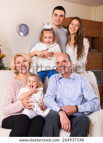 Big united family members laughing together in living room - stock photo