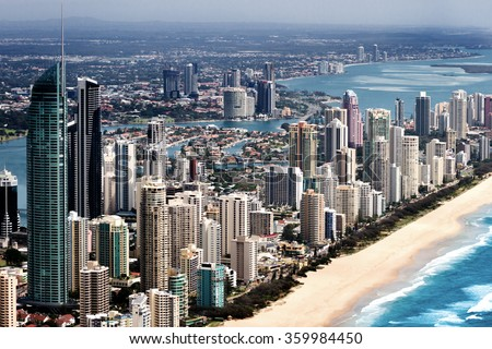 Big urban city with tall skyscapers located on a coast in Queensland, Australia - stock photo
