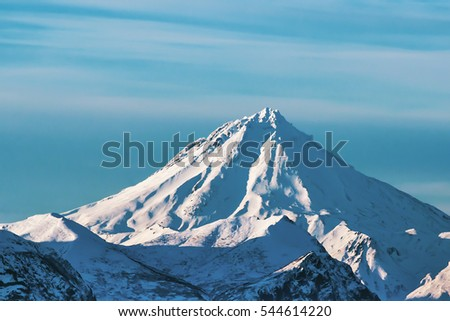 big volcano covered with snow