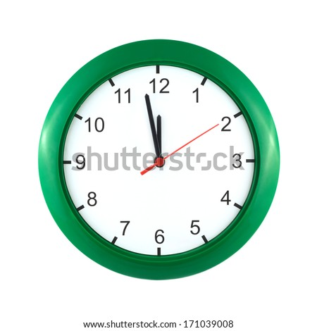 Big wall clock shows almost twelve o'clock isolated on white close up - stock photo