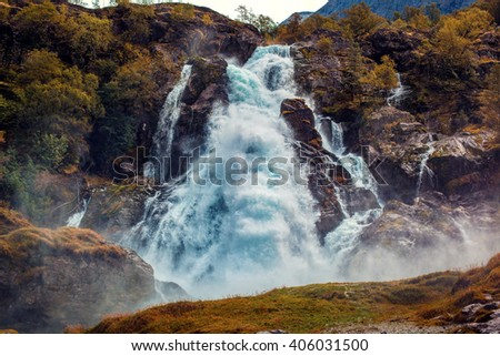 Big waterfall in Norway autumn red colors - stock photo