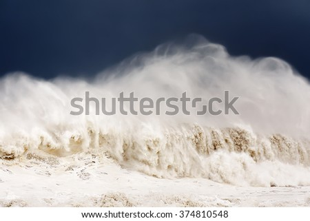 big wave breaking on windy day - stock photo
