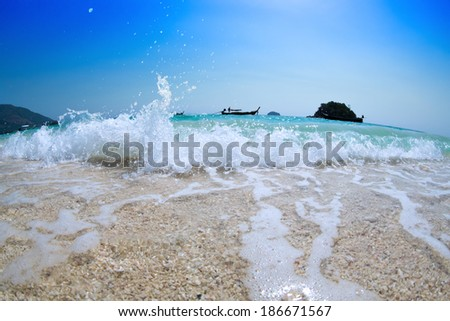 big wave on beautiful beach. tropical sea in Thailand