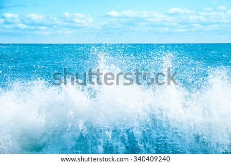 Big wave on the blue sea. Surf and foam - stock photo