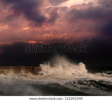 Big waves during a storm in the Portuguese coast - north side of Leixoes harbor - Porto; enhanced sky - stock photo