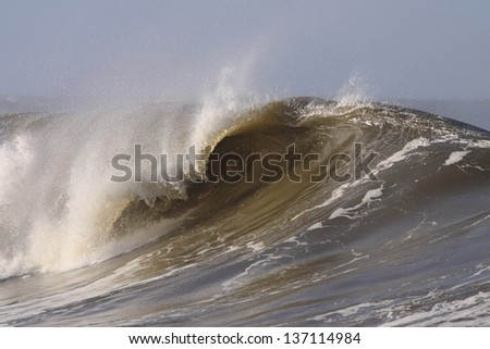 Big waves on the Portuguese coast in a sunny but stormy morning - stock photo