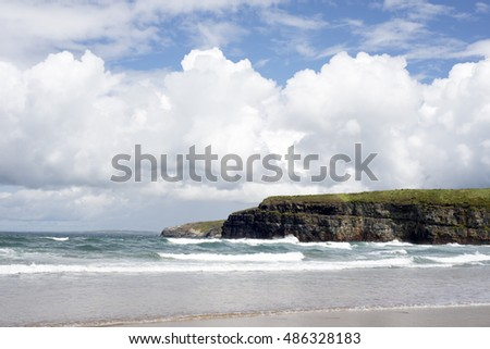 big waves rolling into the cliffs and beach in ballybunion on the wild atlantic way