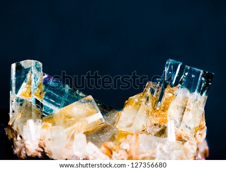 Big well formed Aquamarine crystals on matrix rock. Birthstone for March. Healers use aquamarine for problems related to thymus gland and fluid retention. Found in Pakistan. - stock photo