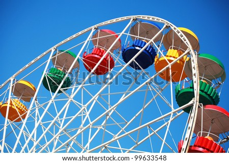 big wheel with multicolored cabins - stock photo