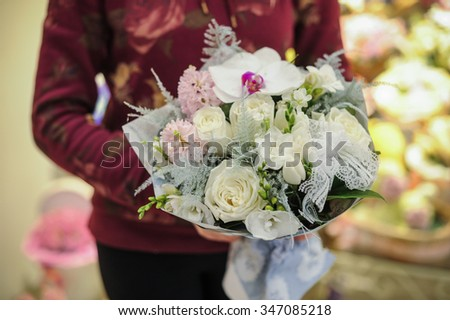 big white bouquet with huge orchids in hands