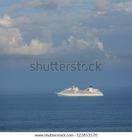 Big White Cruise Ship in the Open Sea - stock photo