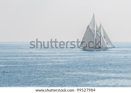 Big white yacht sailing blue sea. Lots of copy space. - stock photo