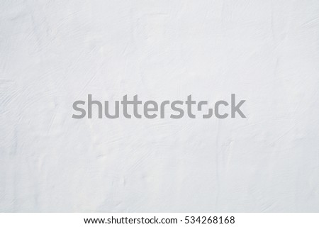 Big whitewashed white painted textured wall background.