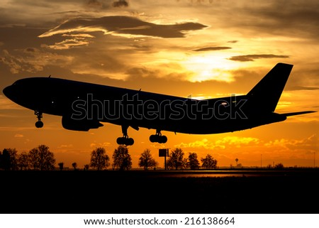 Big wide body Airbus landing in the sunset - stock photo
