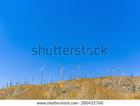big wind turbines in San Francisco under blue sky - stock photo