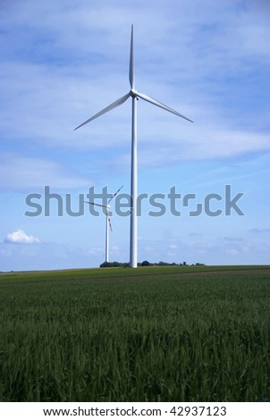 big windmill green field meadow blue sky