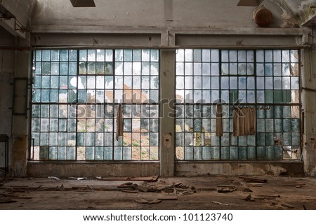 big windows in the workshop hall factory - stock photo