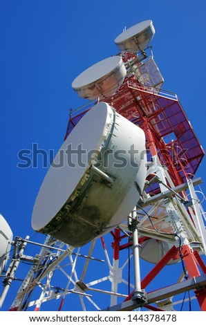 Big wireless communications antenna over clear blue sky - stock photo