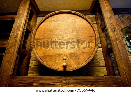 Big wood barrel in old wines cellar - stock photo