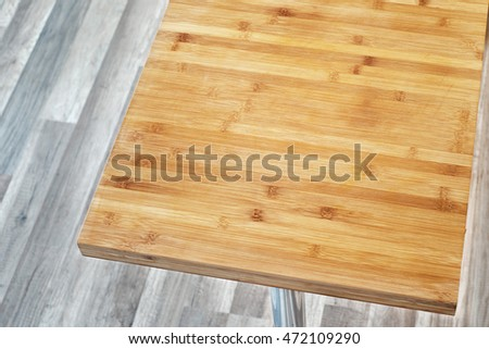 big wooden cutting board on the table in kitchen