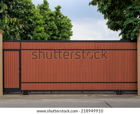 Big wooden slide door entrance to the house with nature garden - stock photo