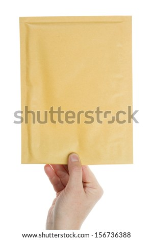 Big yellow envelope in the hand isolated on white background   - stock photo