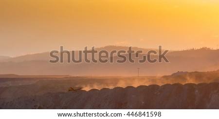 Big yellow mining truck - stock photo