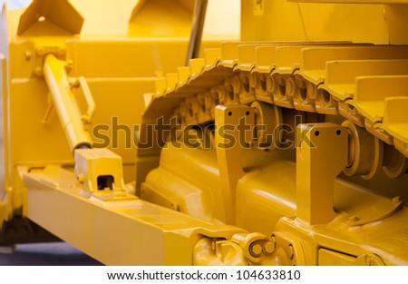 Big yellow track buldozer - stock photo