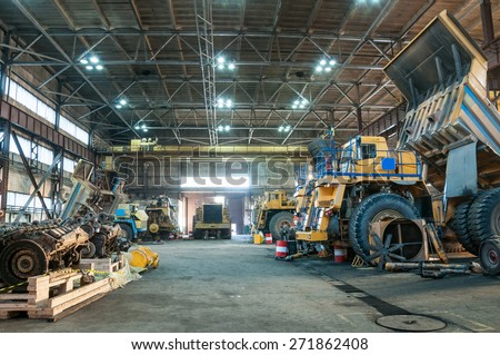 big yellow trucks at technical services box - stock photo
