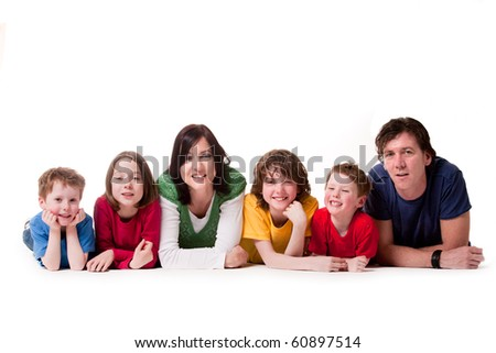 Big young family in a happy colorful mood - stock photo
