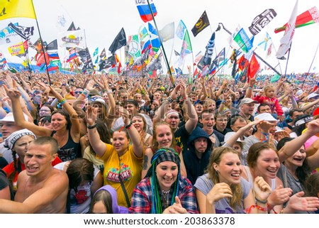 "BIG ZAVIDOVO, RUSSIA - JULY 4: People cheering at open-air rock festival ""Nashestvie"" on July 4, 2014 in Big Zavidovo, Russia. ""Nashestvie"" is the biggest rock festival in Russia, more 200000 visitors"