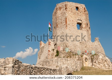 Biggest tower of Castle Csesznek with Hungarian flag