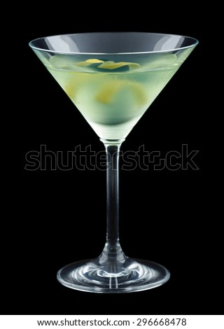 Bijou is a classic cocktail that contains gin, green chartreuse, sweet vermouth and orange bitters. Garnished with a lemon twist. Isolated on black. - stock photo