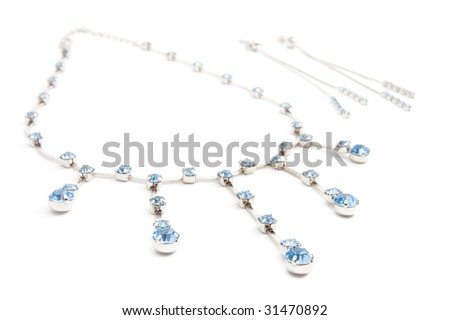 Bijouterie and earring isolated on white