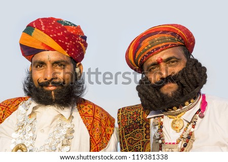 BIKANER, INDIA-JANUARY 08:Portraits of men in competition of the best mustache.Bikaner Camel Festival is an annual festival with competitions for people and camels. January 08,2012 in Bikaner,India - stock photo