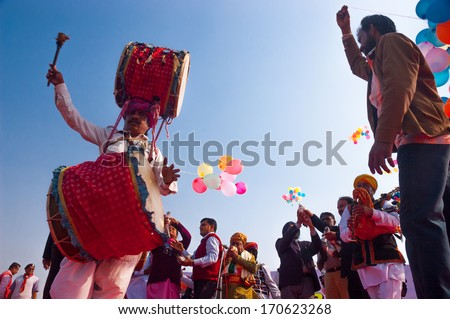 BIKANER, INDIA - January 10: Unidentified people participate in Camel Festival on January 10, 2009 in Bikaner, Rajastan, India.  The pageant takes place in January in Bikaner every year. - stock photo