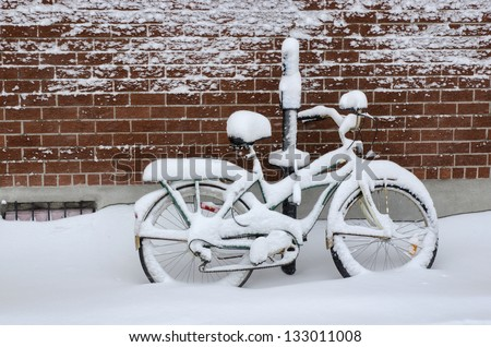 Bike covered with fresh snow in Montreal - stock photo