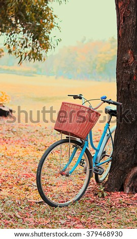 Bike for leisure travel ( Focus at basket ) in vintage retro tone - stock photo